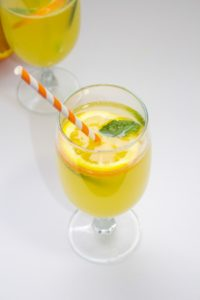 Sparkling-Orange-Drink-with-striped-straws