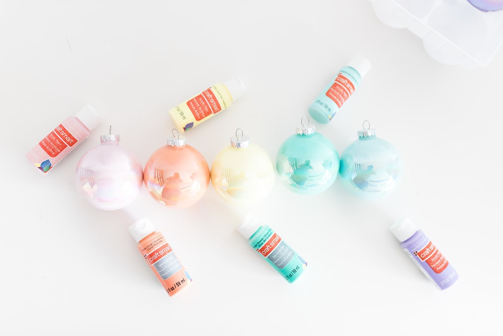 i thought the vibrant pastel paint colors would mix together perfectly in each iridescent christmas ornament these stylish ornaments are so easy to make