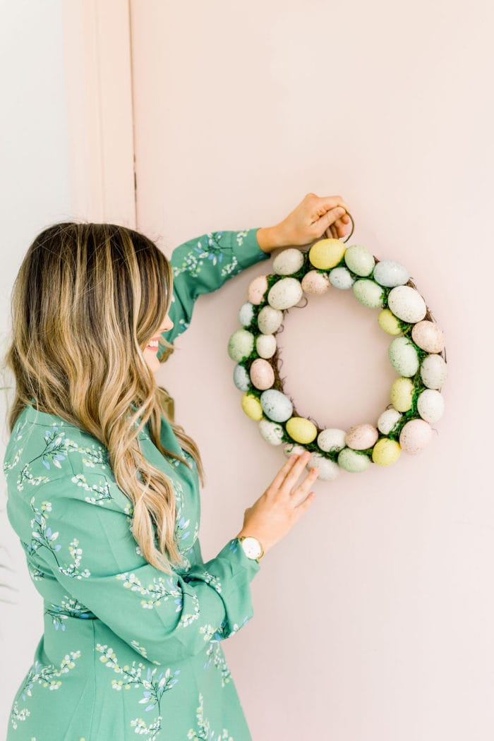 hanging up easter wreath