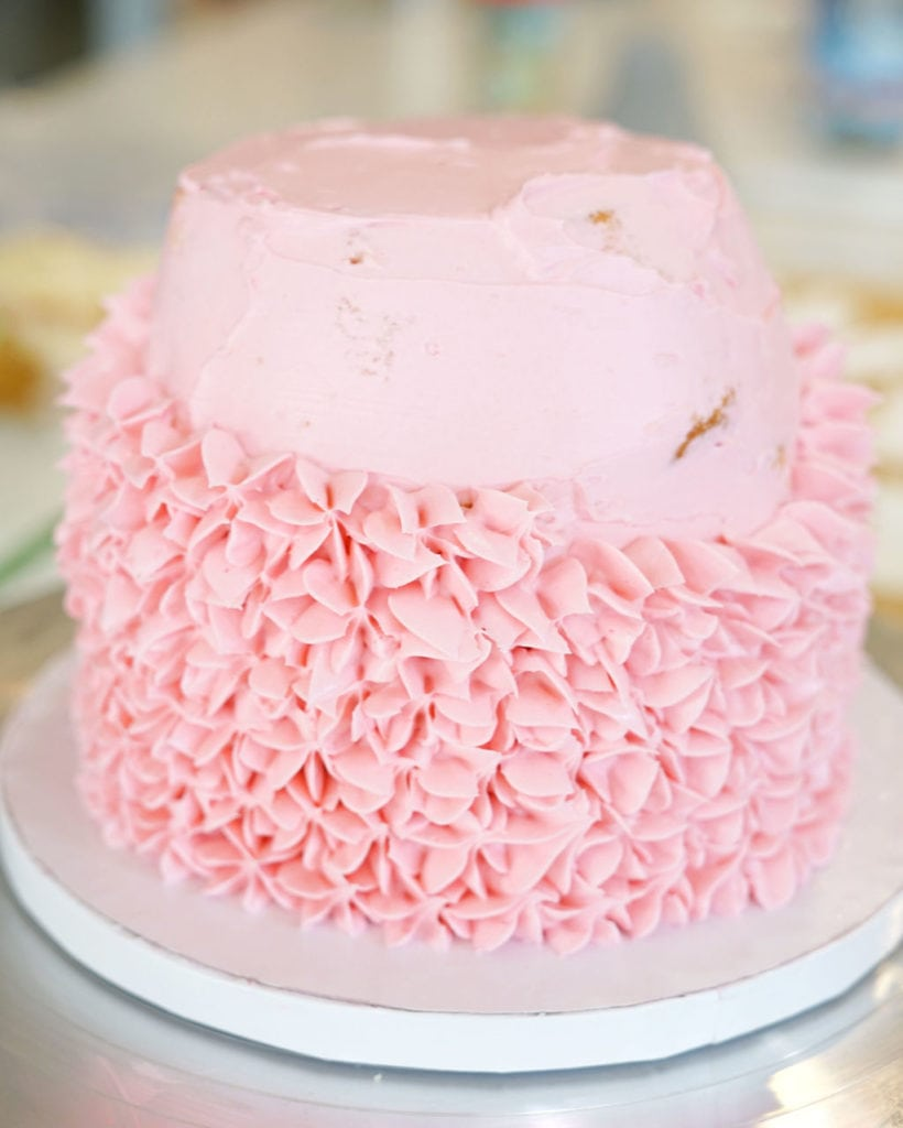 pink frosting on cake