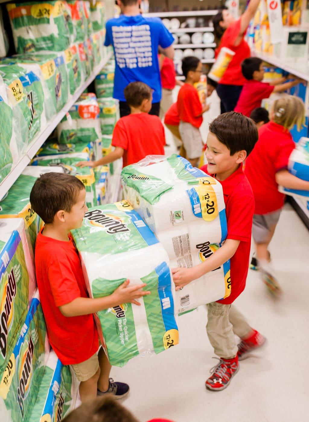 kids holding paper towel