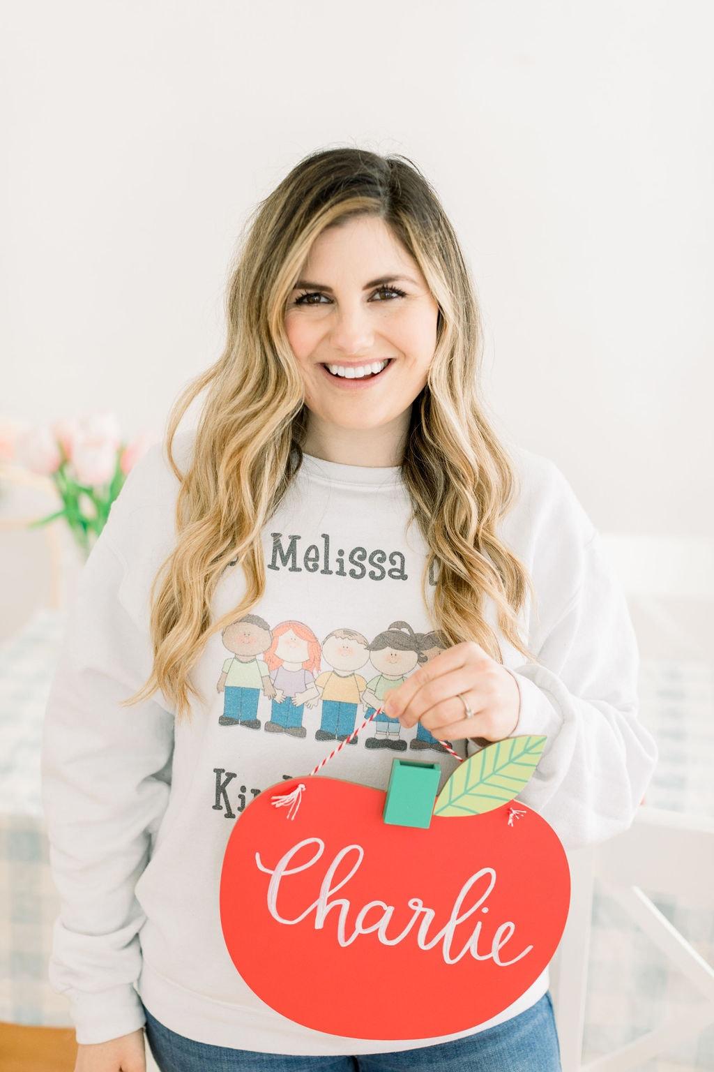girl holding name sign