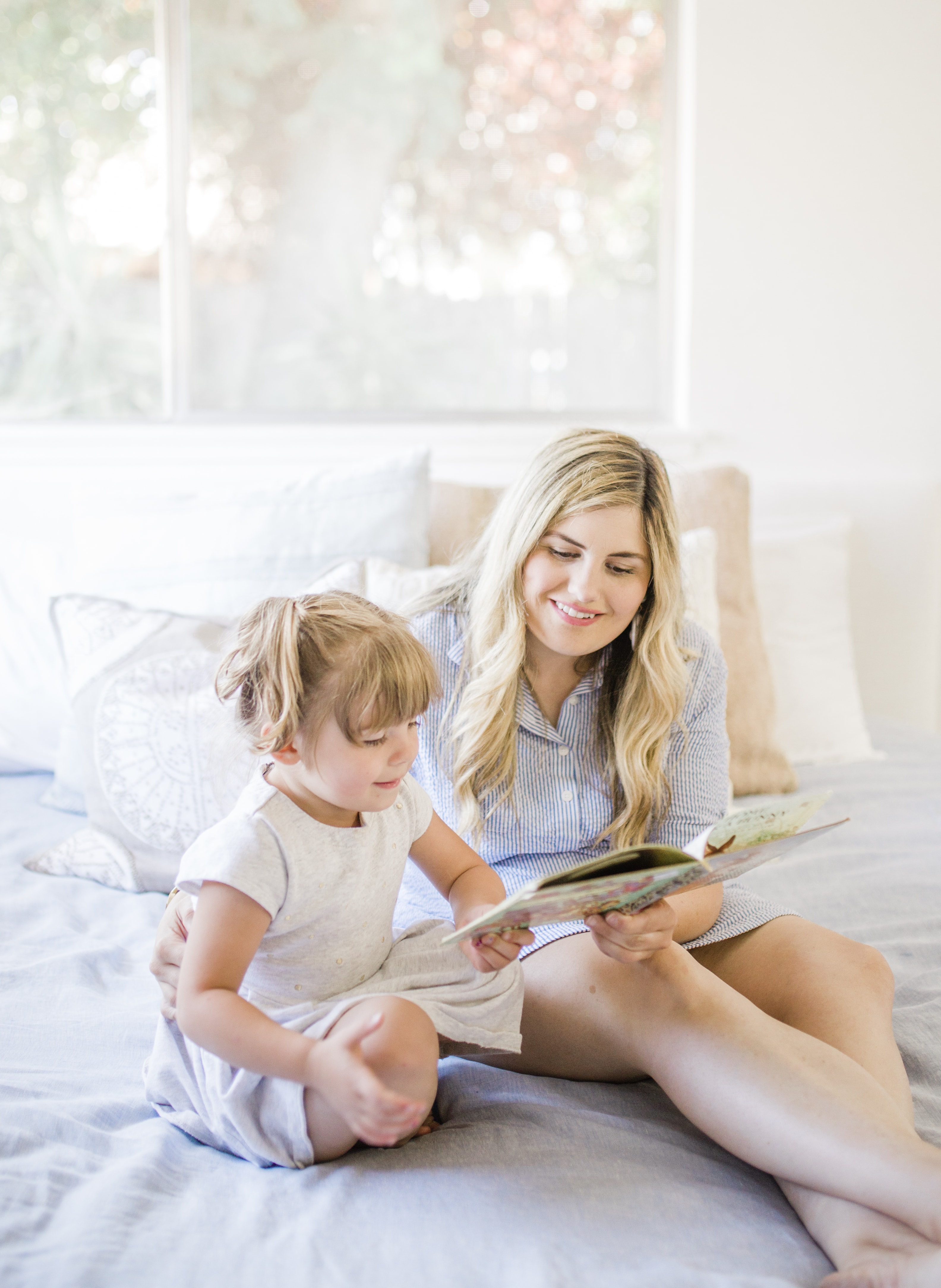 girl reading on her bed