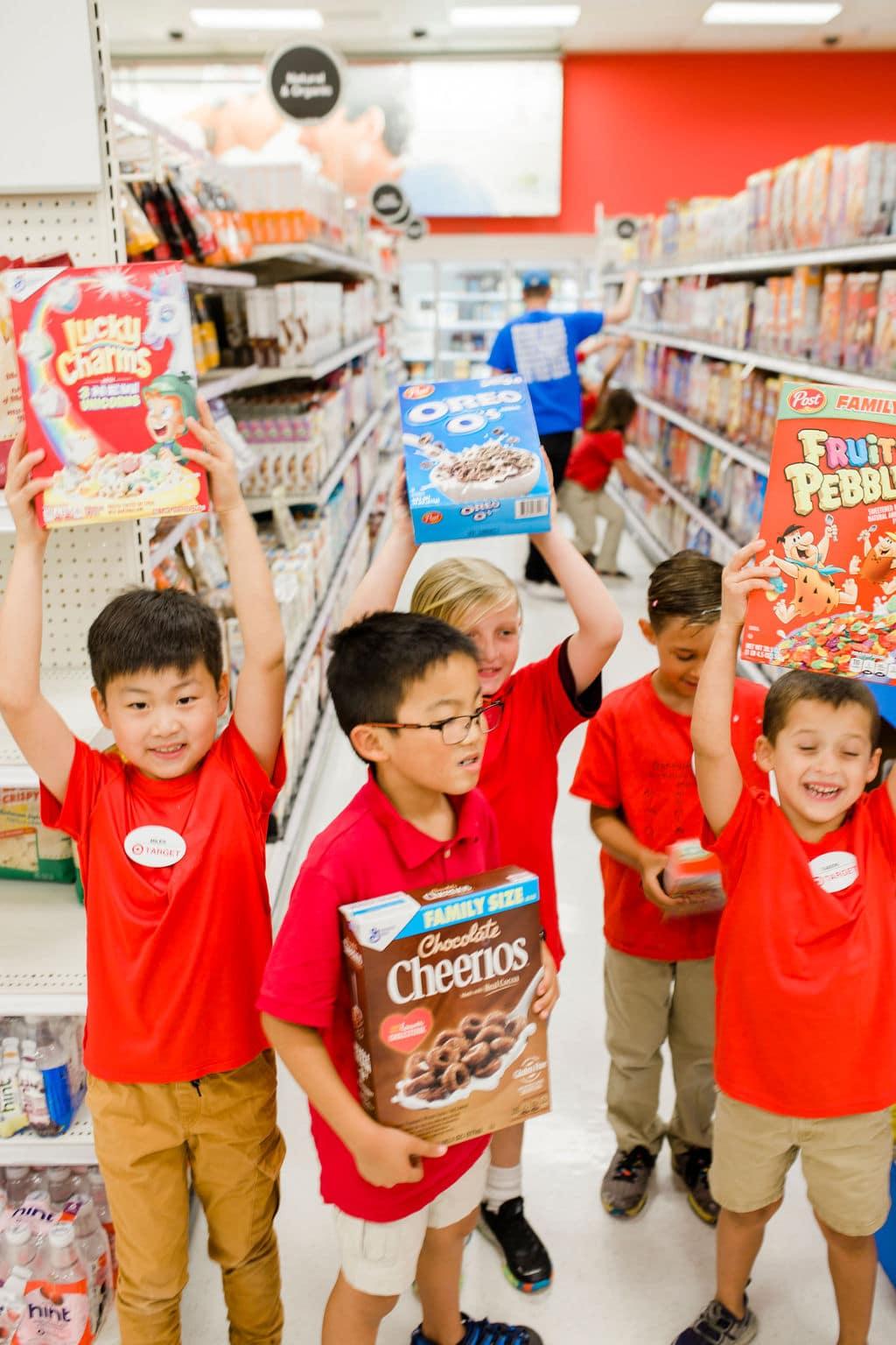 kids holding cereal
