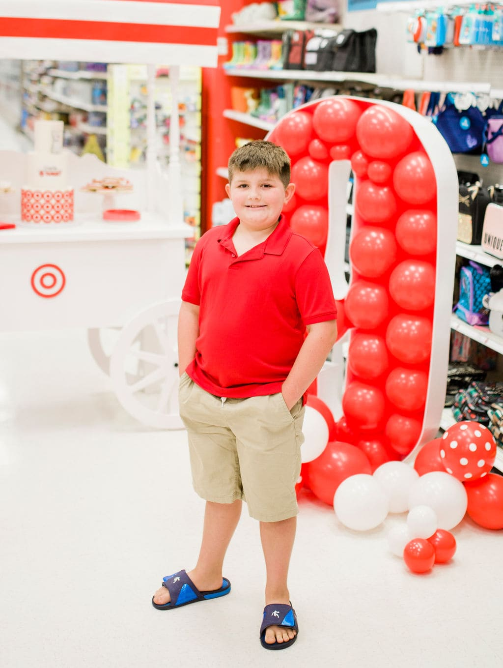 kids standing in front of balloons