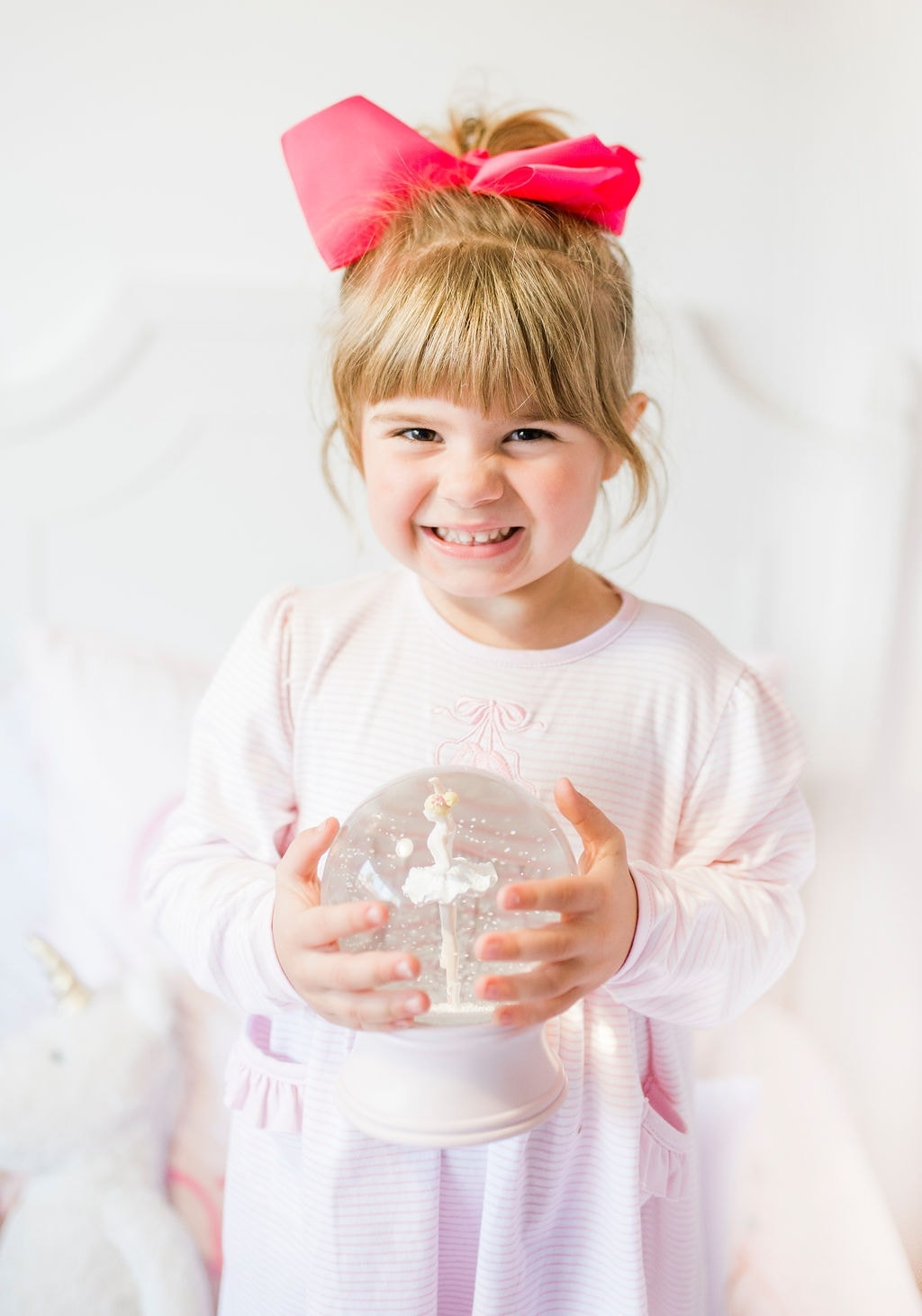 girl holding snow globe