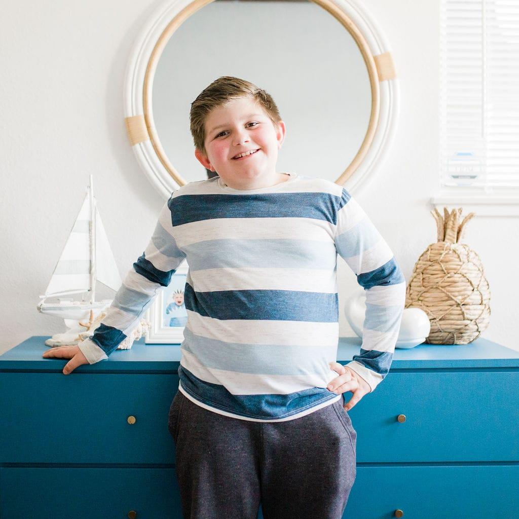 standing in front of dresser