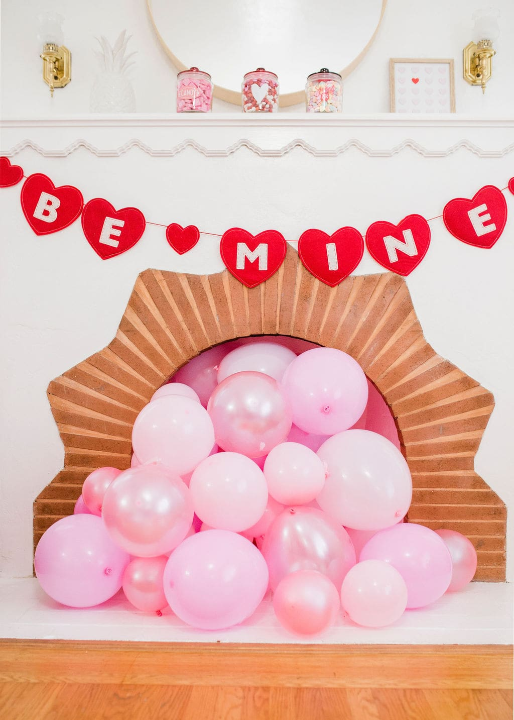 pink balloons in fireplace